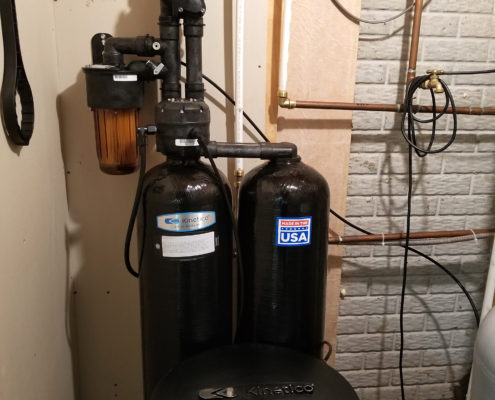 This Kinetico water system replaced a 3 year old Culligan that was still letting iron through